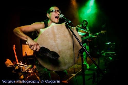 Ra Djan on stage with Shamanic frame drum sings Ra Maayan